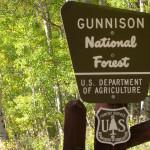 gunnison park sign with aspens