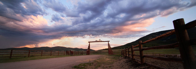 sunset over Ranch gate